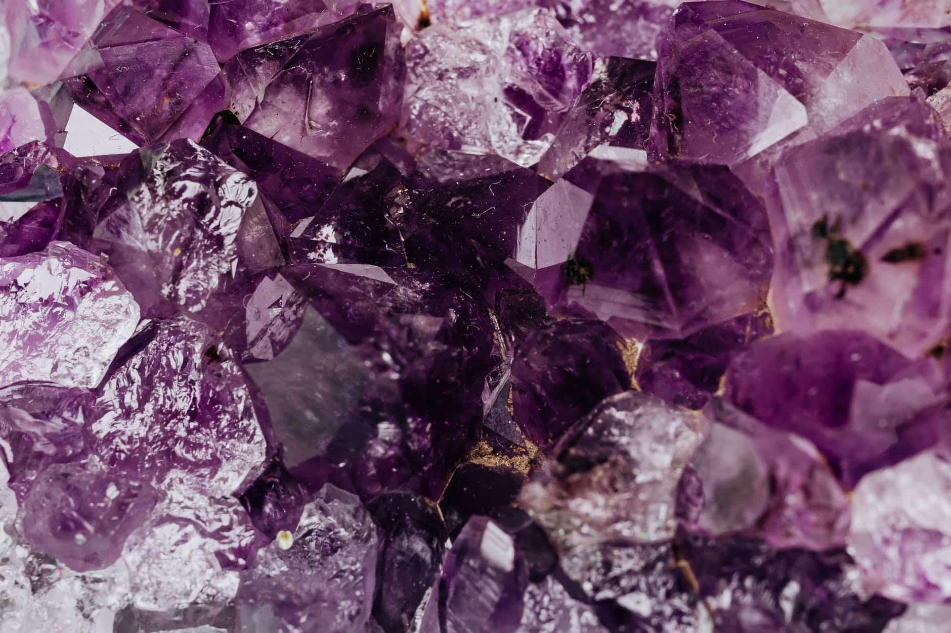 set of shiny transparent amethysts grown together